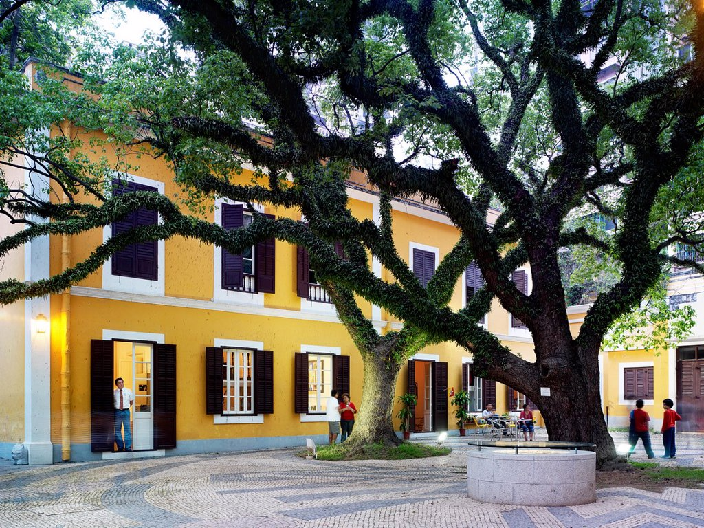 Stock Photo: 1566-1063624 The outside patio/garden and gathering place at the Lar das Idosas da Santa Casa de Mesiricordia where Macanese of all ages congregate, socialize and spend time with one another