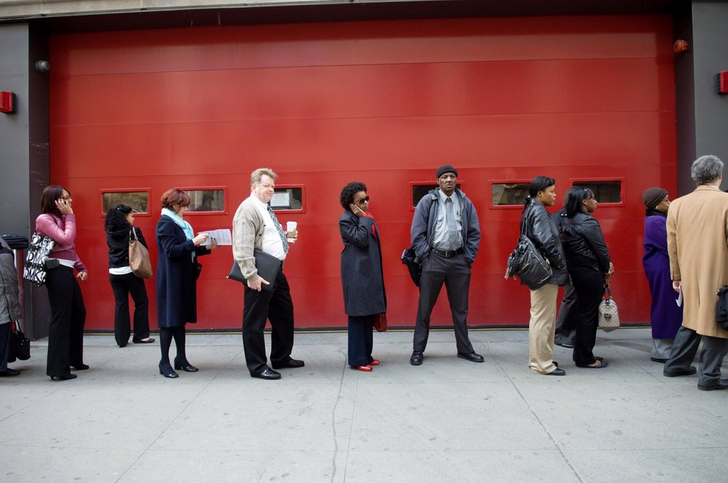 Job seekers line up for a job fair in midtown in New York : Stock Photo