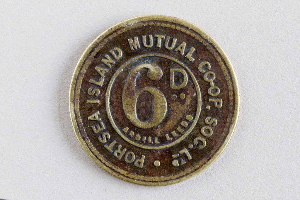 Stock Photo: 1566-1064411 Co-op token, 6d, Portsea Island Co-op Society, UK