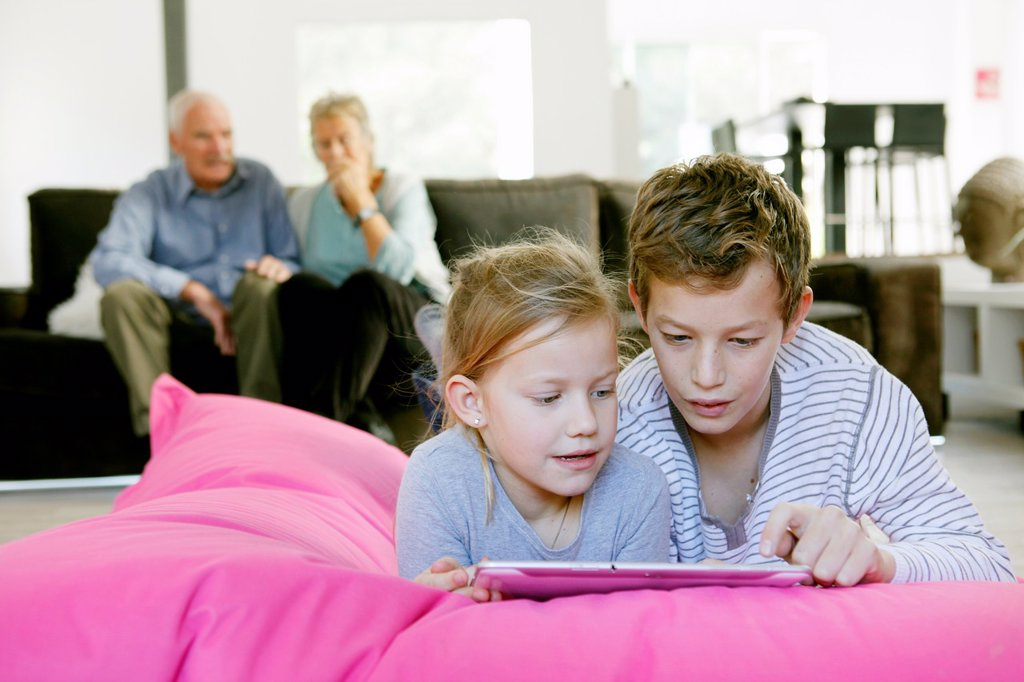 Stock Photo: 1566-1064704 Children using tablet computer