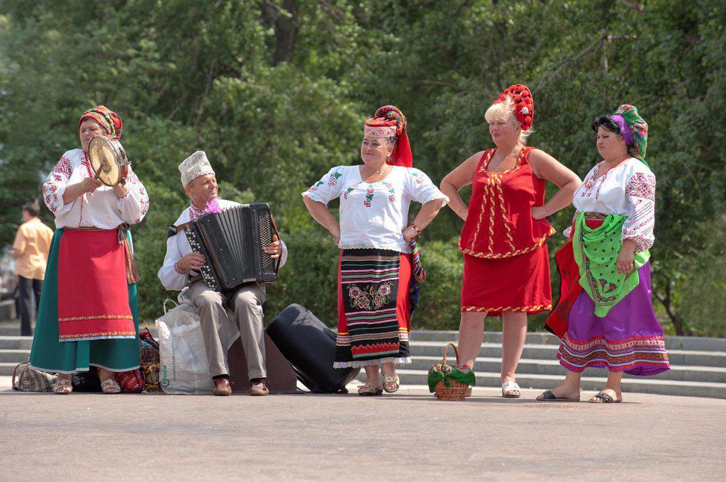Entertainers in national costume, Kiev, Ukraine, Europe : Stock Photo
