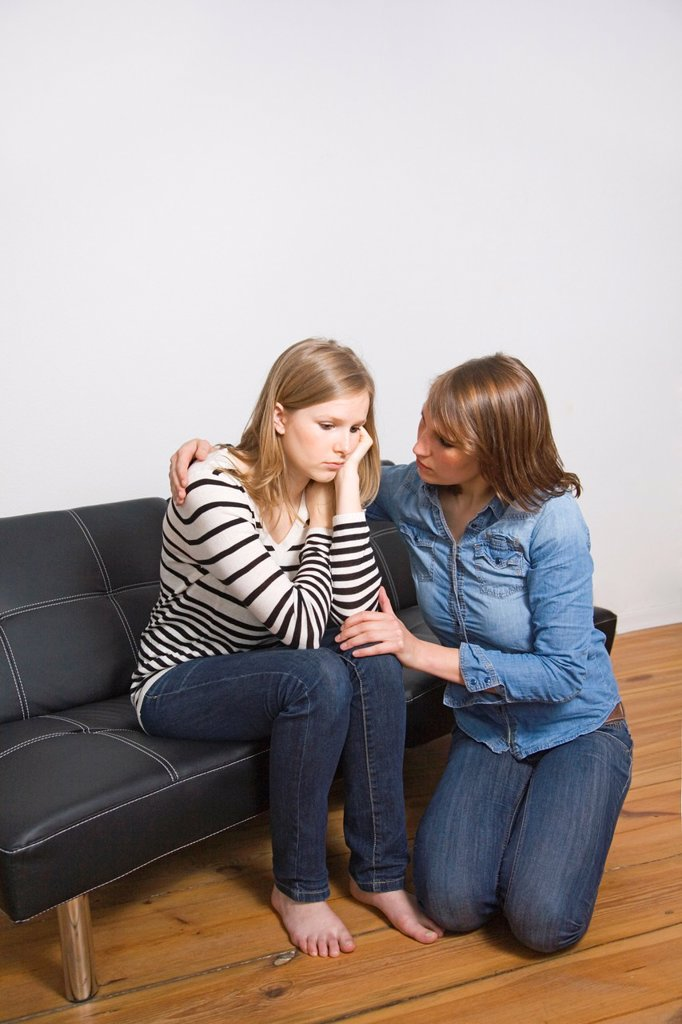 Stock Photo: 1566-1066118 Woman consolating her friend at home