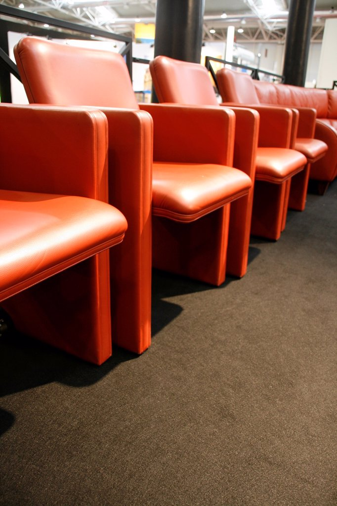 rows of modern leather chairs for vip at an indoor parade event : Stock Photo