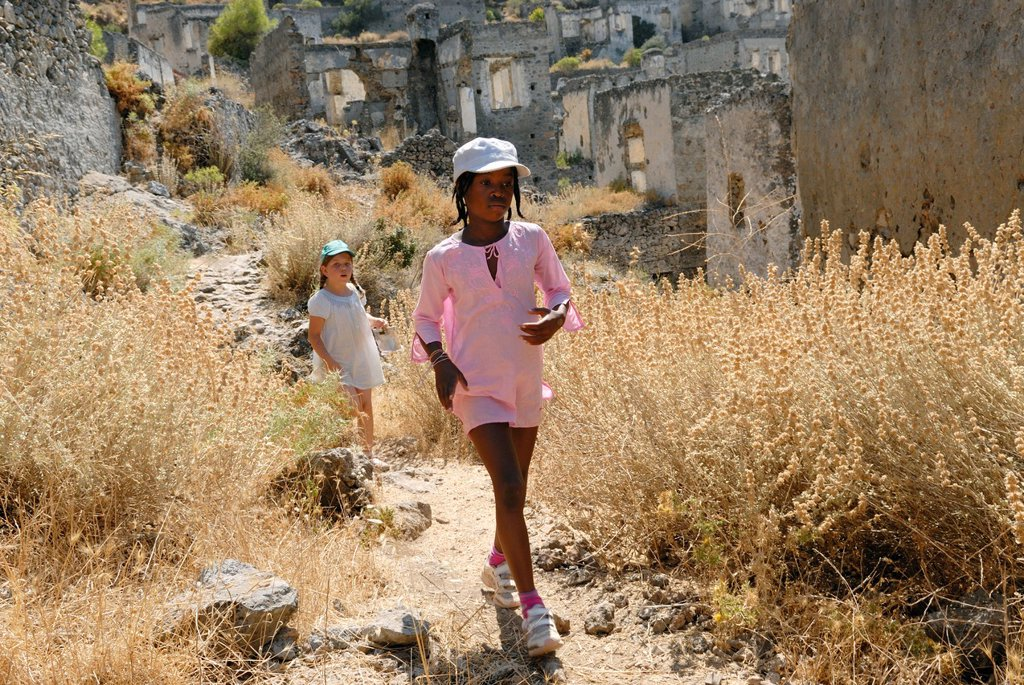 Stock Photo: 1566-1066336 little girls in Kayakoy which was a Greek speaking village, it was abandonned after a population exchange agreement was signed by the Turkish and Greek governments in 1923, Turkey, Eurasia
