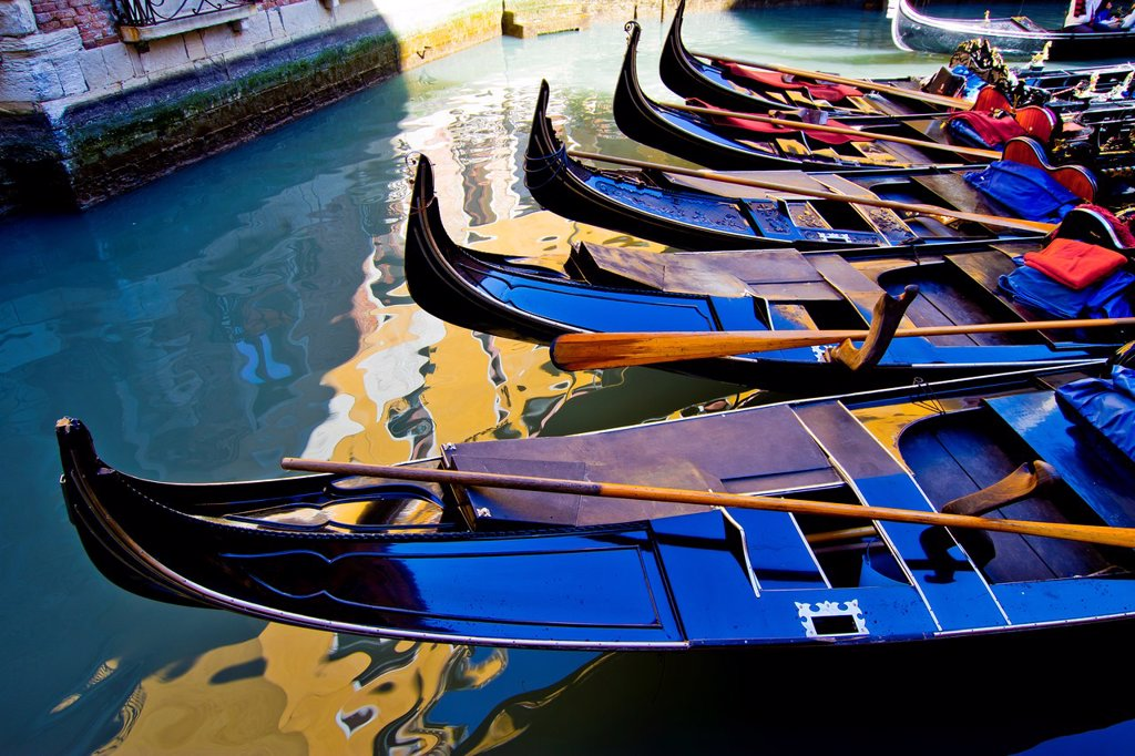 Gondolas in a canal  Venice, Italy : Stock Photo