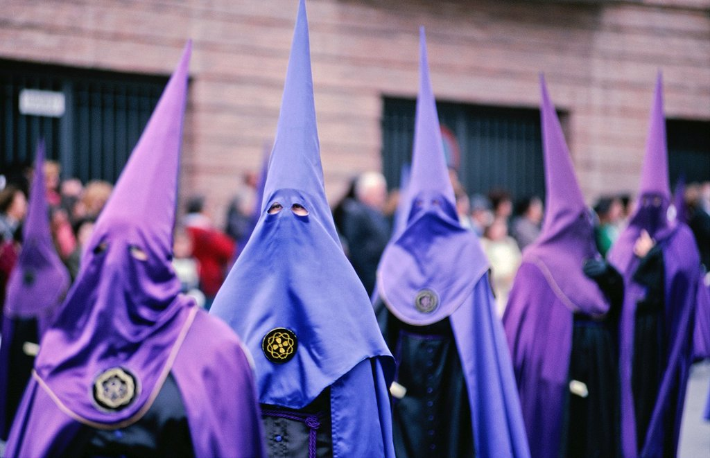 Penitents taking part in a procession, during the Semana Santa holy week festivities in Guadix, Granada Provice, Southern Spain : Stock Photo