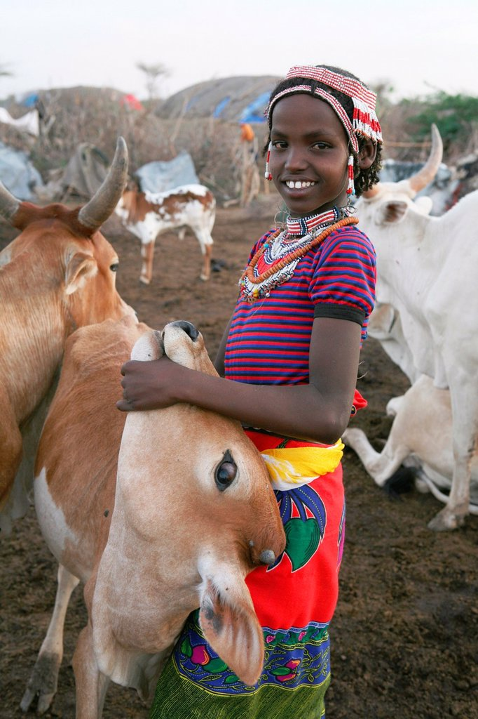 Stock Photo: 1566-1067333 Ethiopian people living in the North of the country are related to Somali people They are nomadic and live from cattle farming Most of them however, live in a village Girls and women have the responsibility of milking the cows because too little pasture,