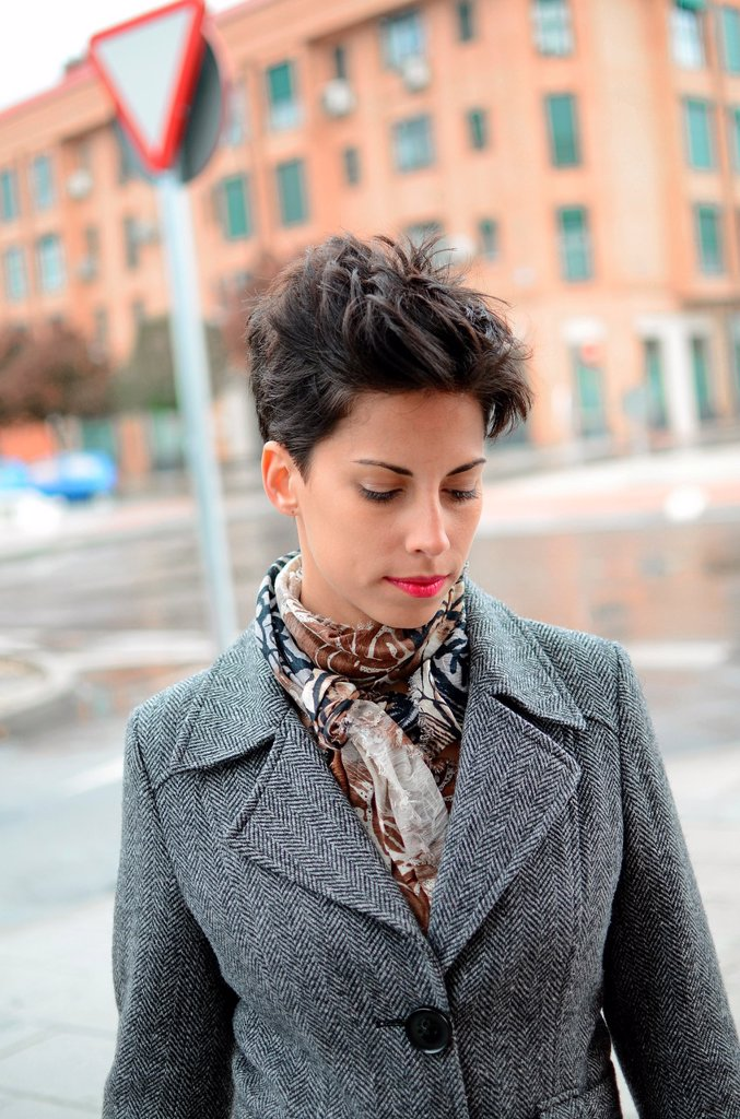 Exterior portrait of attractive young short haired woman : Stock Photo
