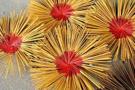 Stock Photo: 1566-1067580 Vietnam, Hue, manufactures incense sticks.