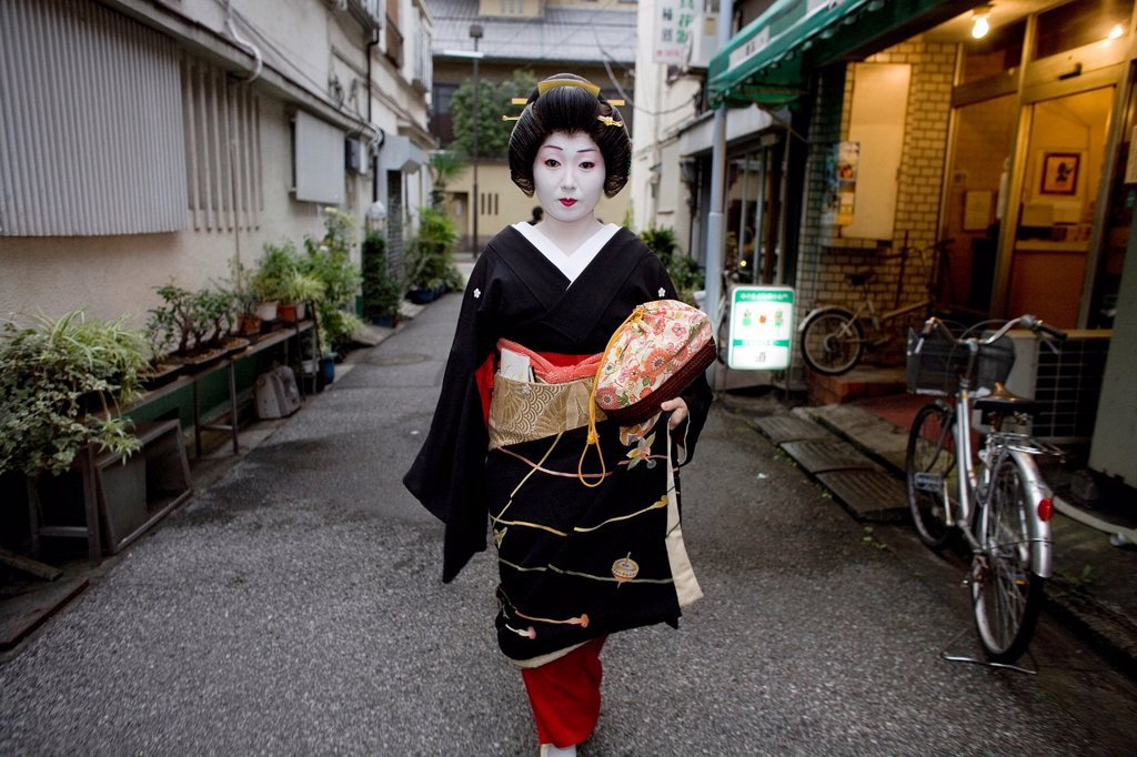 Stock Photo: 1566-1067653 Geishas are famous in Japan The concept has a long history and goes back several centuries where geishas were for entertainment for rich japanese people They are well trained in dance, language, music instruments and etiquette Nowadays, geishas still p