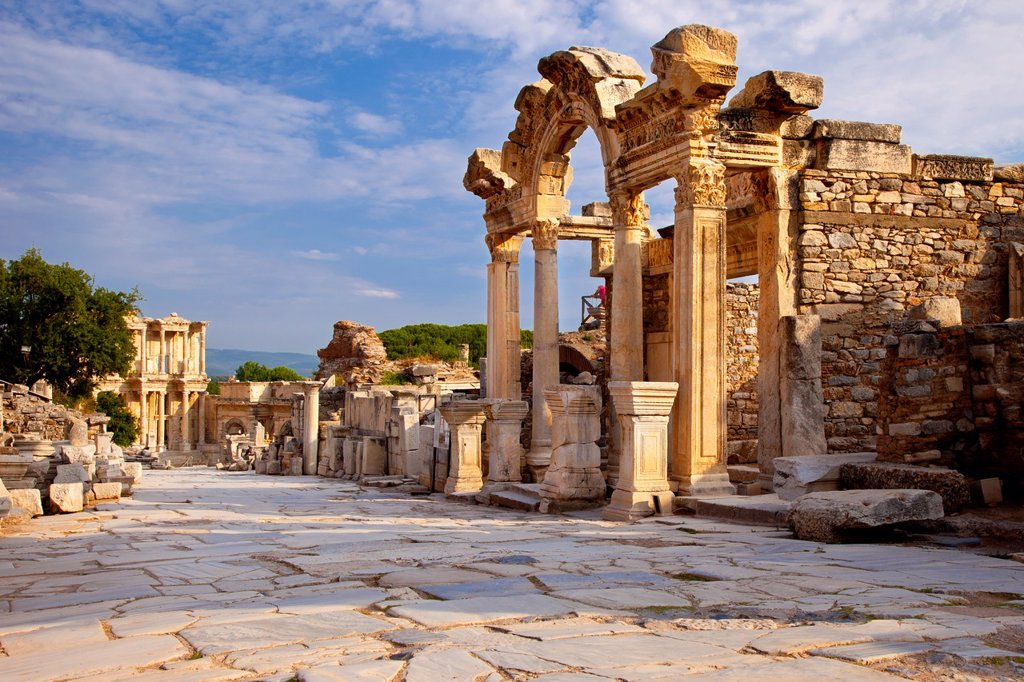 Temple of Hadrian with Library of Celsus beyond along paved Street of Curetes in ancient Ephesus, near Selcuk Turkey : Stock Photo