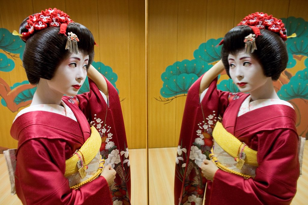 Stock Photo: 1566-1068012 Geishas are famous in Japan The concept has a long history and goes back several centuries where geishas were for entertainment for rich japanese people They are well trained in dance, language, music instruments and etiquette Nowadays, geishas still p