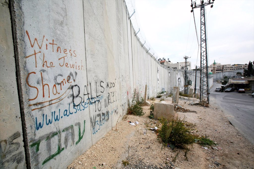 Stock Photo: 1566-1069043 Grafitti protesting the wall that Israel is building around the west bank territories, blocking access for Palestinians who feel imprisoned by it