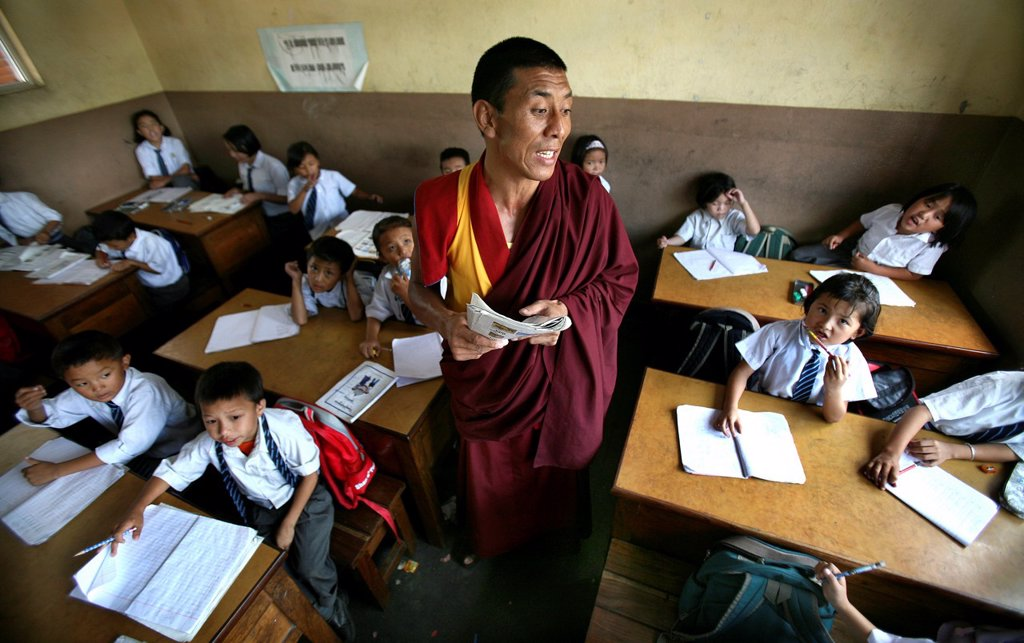 All Tibetan children in Nepal refugees are going to special Tibetan boarding schools where they are thought : Stock Photo