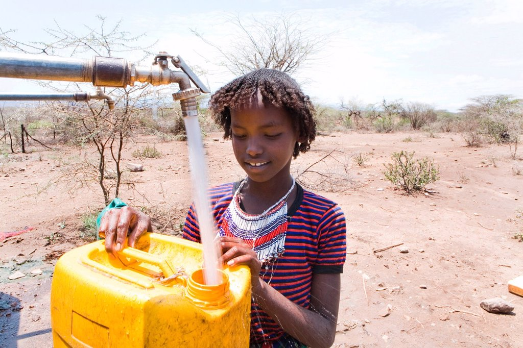 Stock Photo: 1566-1069440 Ethiopian girl fetches drinking water for her family Due to drought, children have to walk for more then one hour before they reach a well which is not dried up