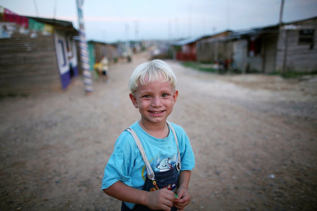 Stock Photo: 1566-1069791 Portrait of a displaced boy in the slums of Colombia