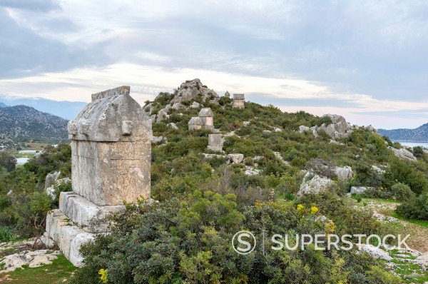 Stock Photo: 1566-1069875 Lycian rock tombs, Kaleköy, Üçagiz Teimiussa, Antalya Province, Turkey