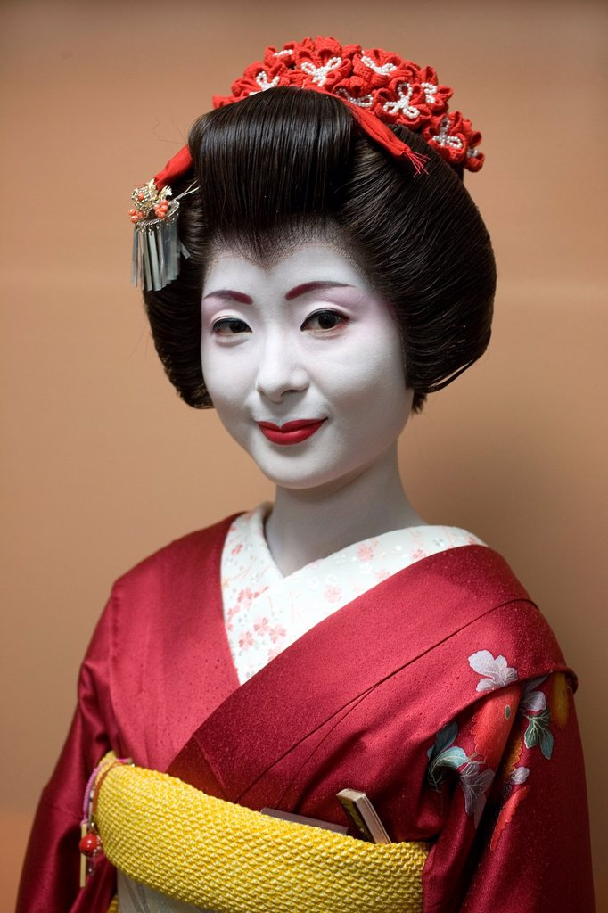 Geishas are famous in Japan The concept has a long history and goes back several centuries where geishas were for entertainment for rich japanese people They are well trained in dance, language, music instruments and etiquette Nowadays, geishas still p : Stock Photo