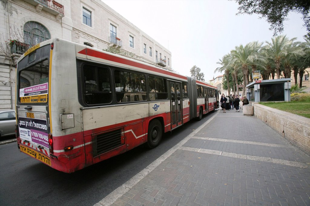 Stock Photo: 1566-1072266 A bus in the old city of Jerusalem