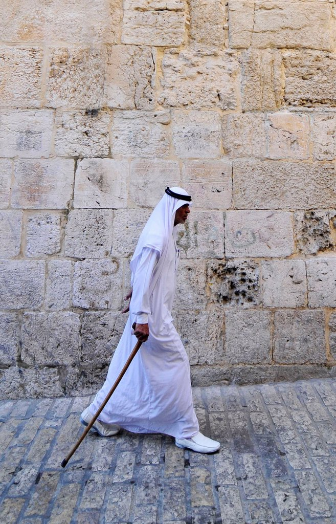 Stock Photo: 1566-1072901 A Bedouin man dressed in traditional Jalaba walking in the old city of Jerusalem
