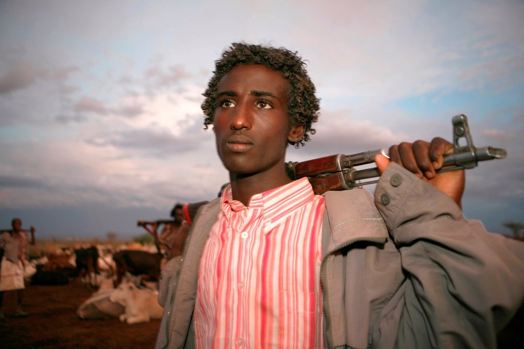 Stock Photo: 1566-1074013 Ethiopian people living in the North of the country are related to Somali people They are nomadic and live from cattle farming Most of them however, live in a village The men are considered adult already on a very young age and have to protect the family