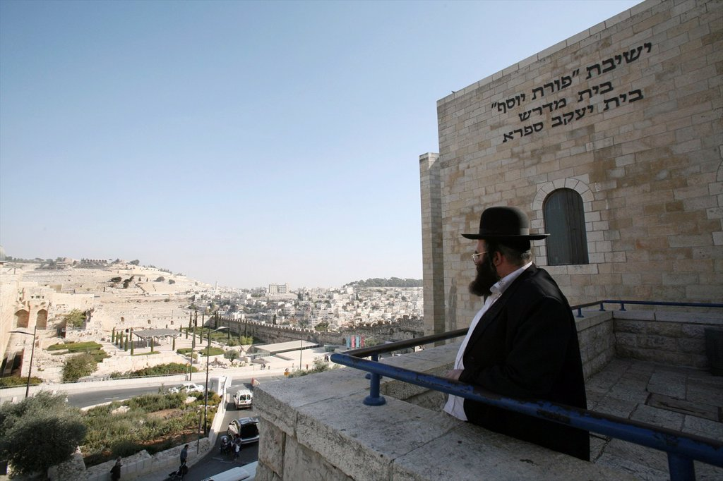 Stock Photo: 1566-1074640 A Jewish man at the Western wailing wall in Jerusalem