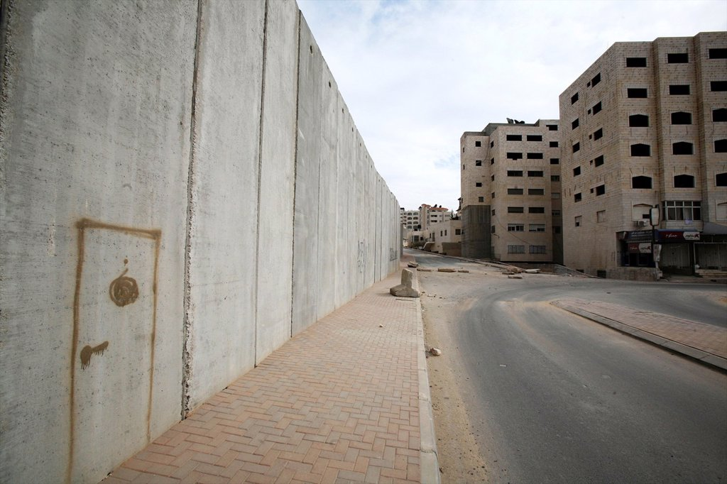 Someone has drawn a door on the wall Israel is building around the west bank territories, blocking access for Palestinians who feel imprisoned by it : Stock Photo