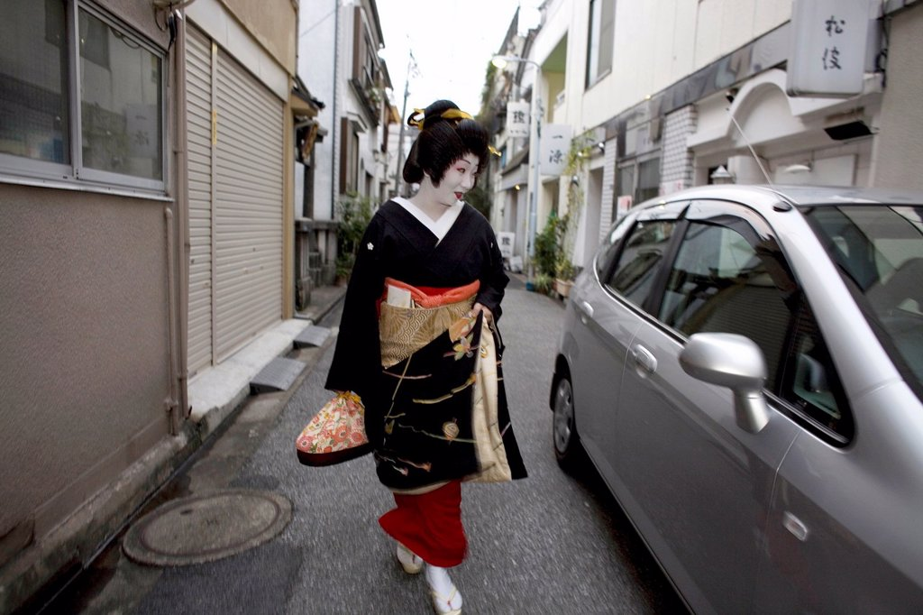 Stock Photo: 1566-1075049 Geishas are famous in Japan The concept has a long history and goes back several centuries where geishas were for entertainment for rich japanese people They are well trained in dance, language, music instruments and etiquette Nowadays, geishas still p