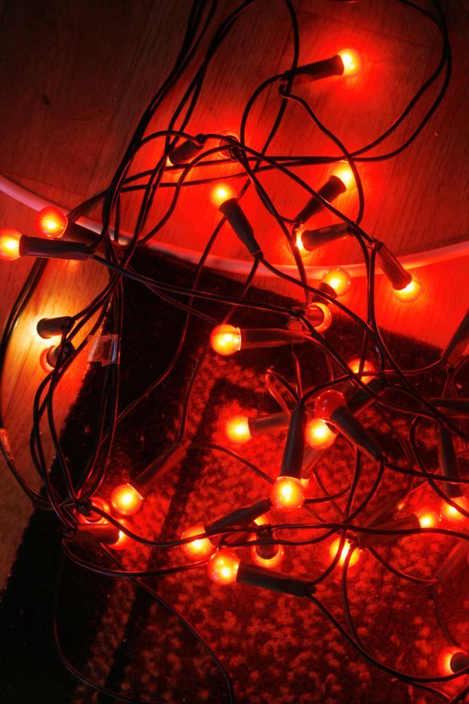 colourful christmas fairy lights on living room floor : Stock Photo