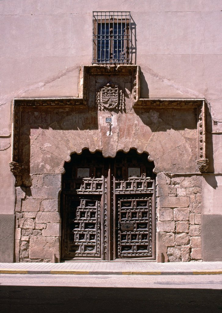The late gothic doorway to the Palacio Episcopal in the Calle Mayor in El Burgo De Osma, Soria province, Spain : Stock Photo