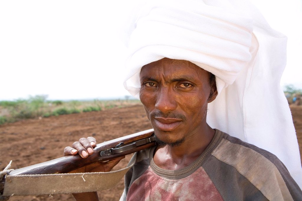 Stock Photo: 1566-1076055 Ethiopian people living in the North of the country are related to Somali people They are nomadic and live from cattle farming Most of them however, live in a village The men are considered adult already on a very young age and have to protect the family