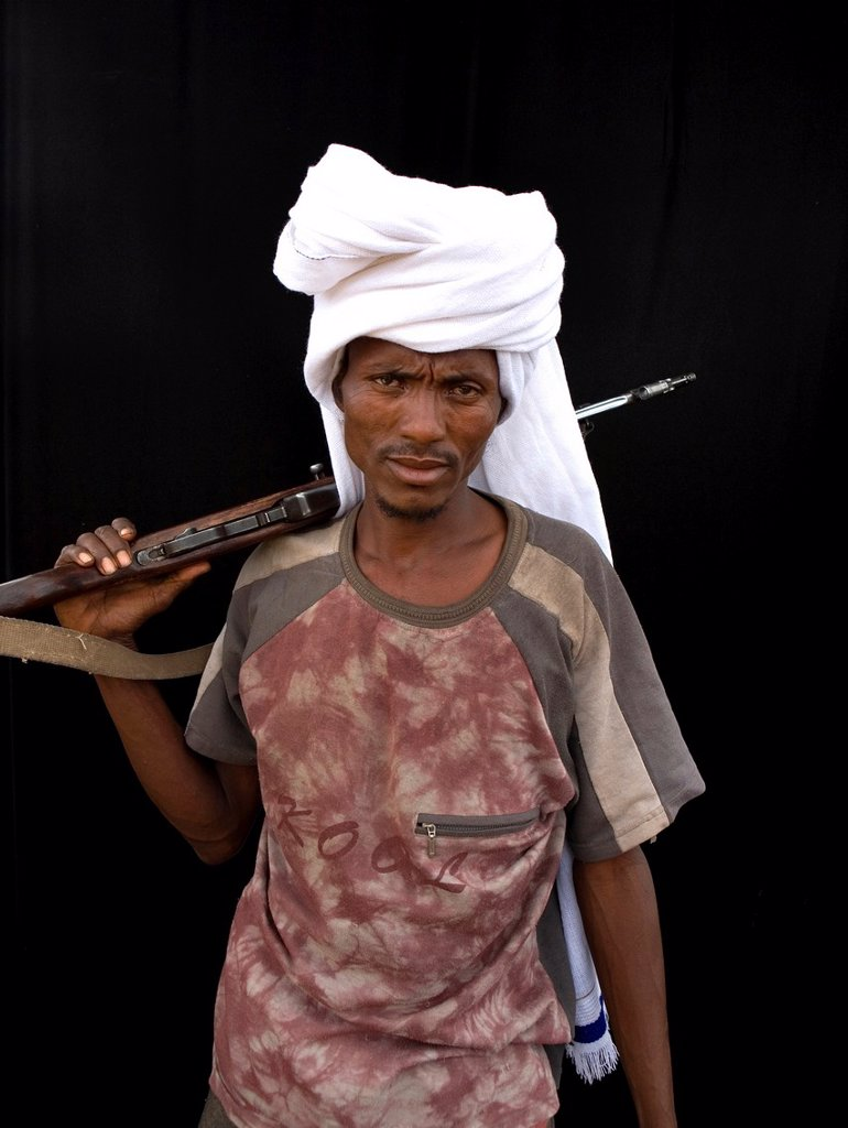 Ethiopian people living in the North of the country are related to Somali people They are nomadic and live from cattle farming Most of them however, live in a village The men are considered adult already on a very young age and have to protect the family : Stock Photo