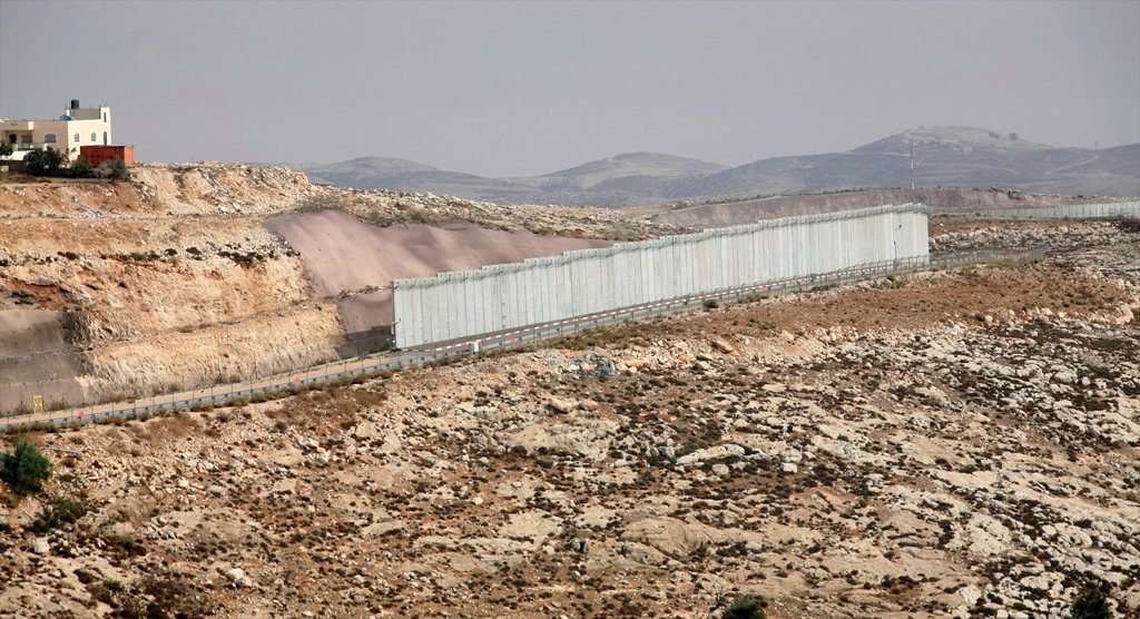 Stock Photo: 1566-1076394 Israel is building a wall around the west bank territories, blocking access for Palestinians who feel imprisoned by it