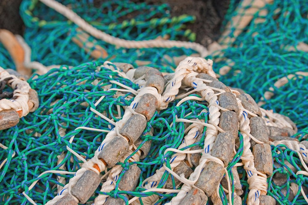 Pacific herring purse seine net and lead line on stack on fishing boat in Sitka, Alaska. : Stock Photo