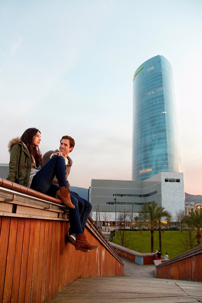 Young couple, Tourists, Iberdrola Tower, Padre Arrupe Bridge, Abandoibarra, Bilbao, Bizkaia, Basque Country, Spain : Stock Photo