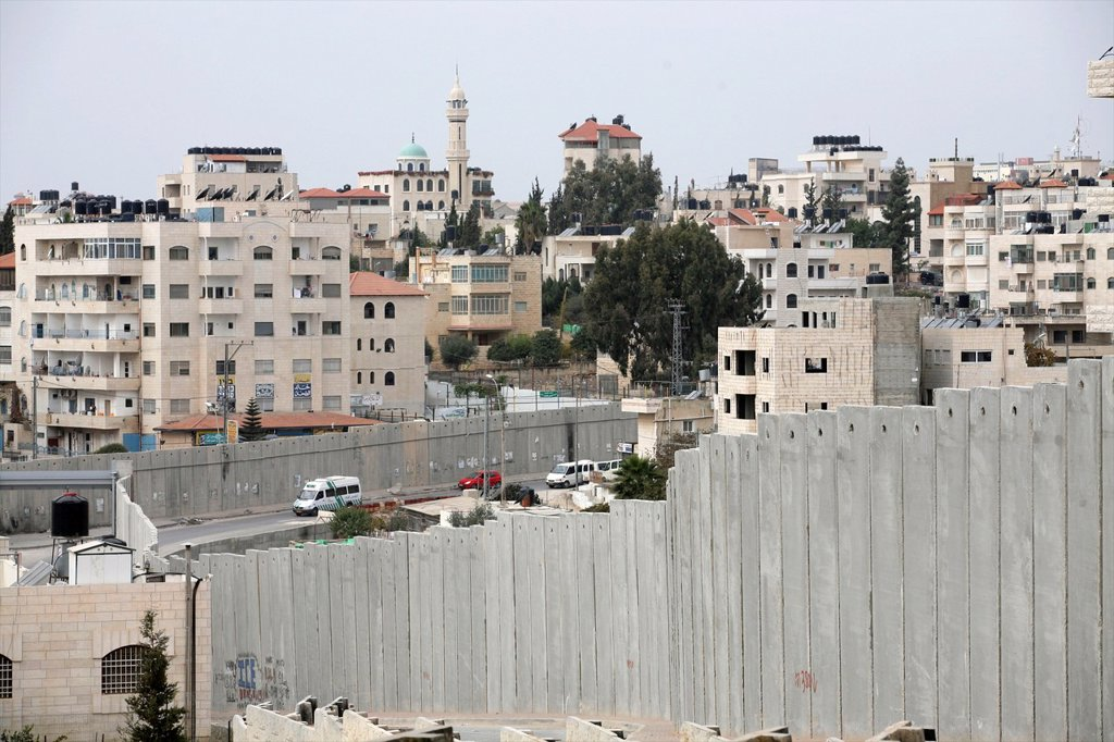 Stock Photo: 1566-1077410 Closeup of fence Israel is building a wall around the west bank territories, blocking access for Palestinians who feel imprisoned by it