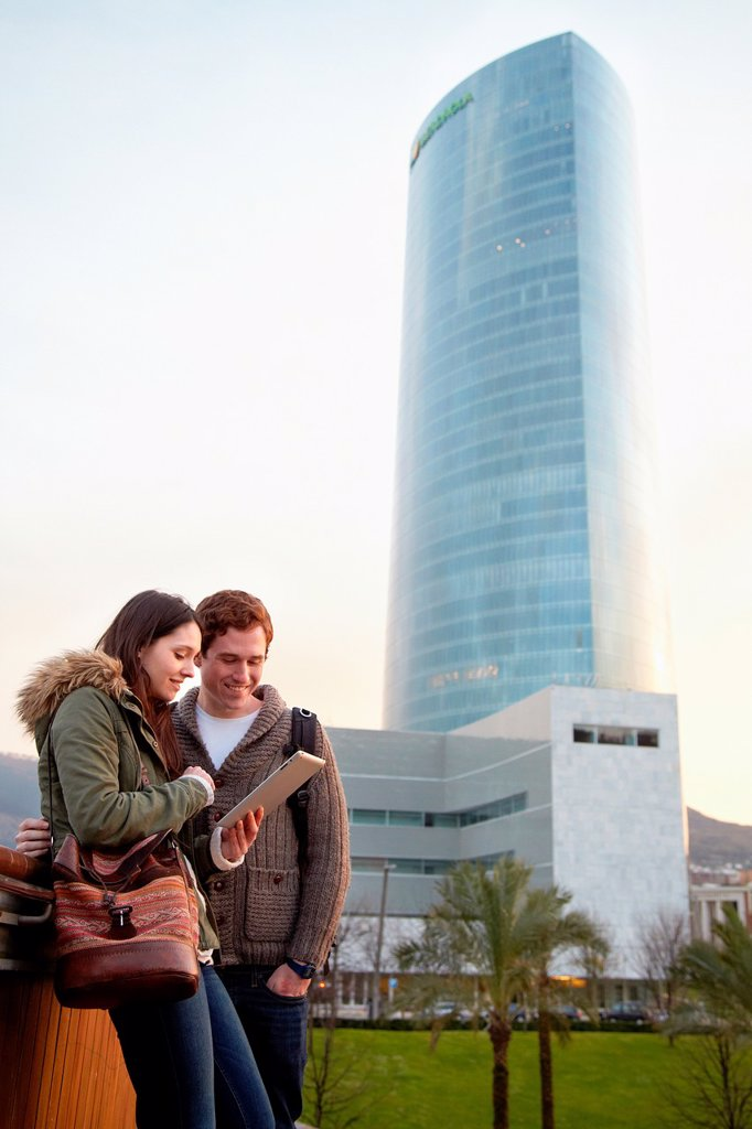 Stock Photo: 1566-1077599 Couple searching on digital tablet in city, digital tablet, Iberdrola Tower, Abandoibarra, Bilbao, Bizkaia, Basque Country, Spain