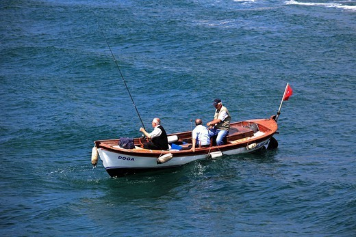 Turkey, Istanbul, Bosphorus, people fishing, small boat. : Stock Photo