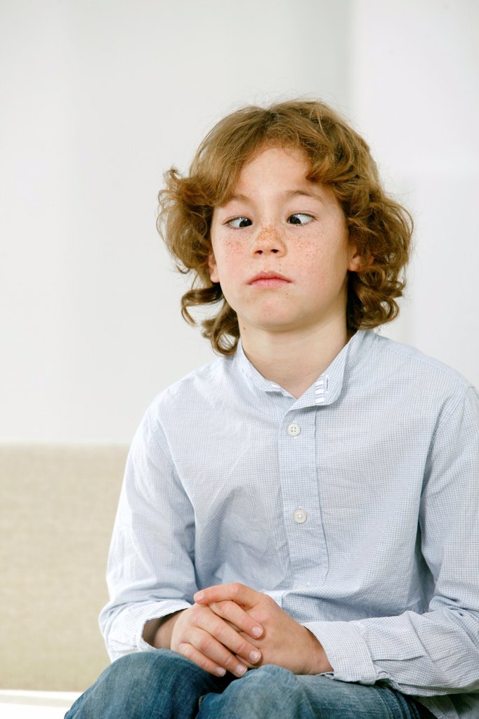 Boy with crossed eyes : Stock Photo
