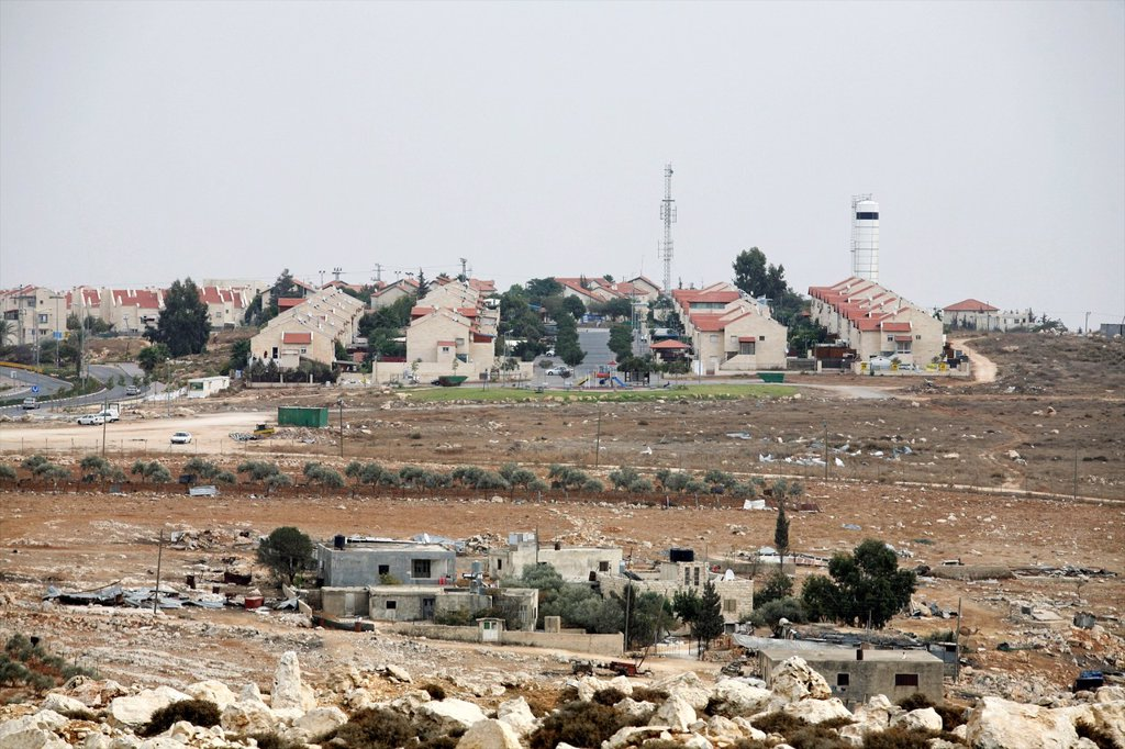 Stock Photo: 1566-1078481 Houses near the wall Israel is building around the west bank territories, blocking access for Palestinians who feel imprisoned by it