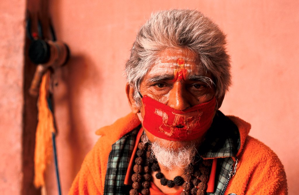 Stock Photo: 1566-1078604 Hindu man doing austerities : he has chosen to be mute to improve his karma. From Devghat, Nepal.