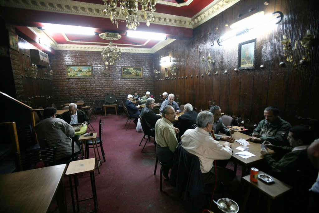 Men relaxing in a tea shop in a market in the old city of Jerusalem : Stock Photo