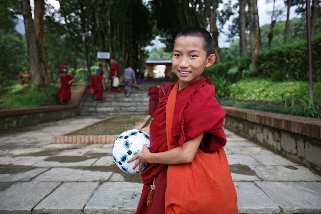Stock Photo: 1566-1081016 Tibetan monks in Kathmandu, Nepal The majority of monks in Nepal are refugees from Tibet and live in monasteries in Nepal Monks playing football