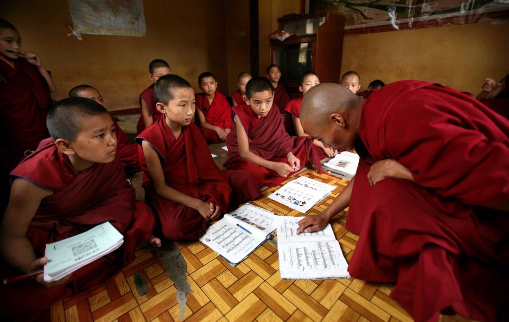 Stock Photo: 1566-1082463 Tibetan monks in Kathmandu, Nepal The majority of monks in Nepal are refugees from Tibet and live in monasteries in Nepal Young monks go also to school every day, within the monastry