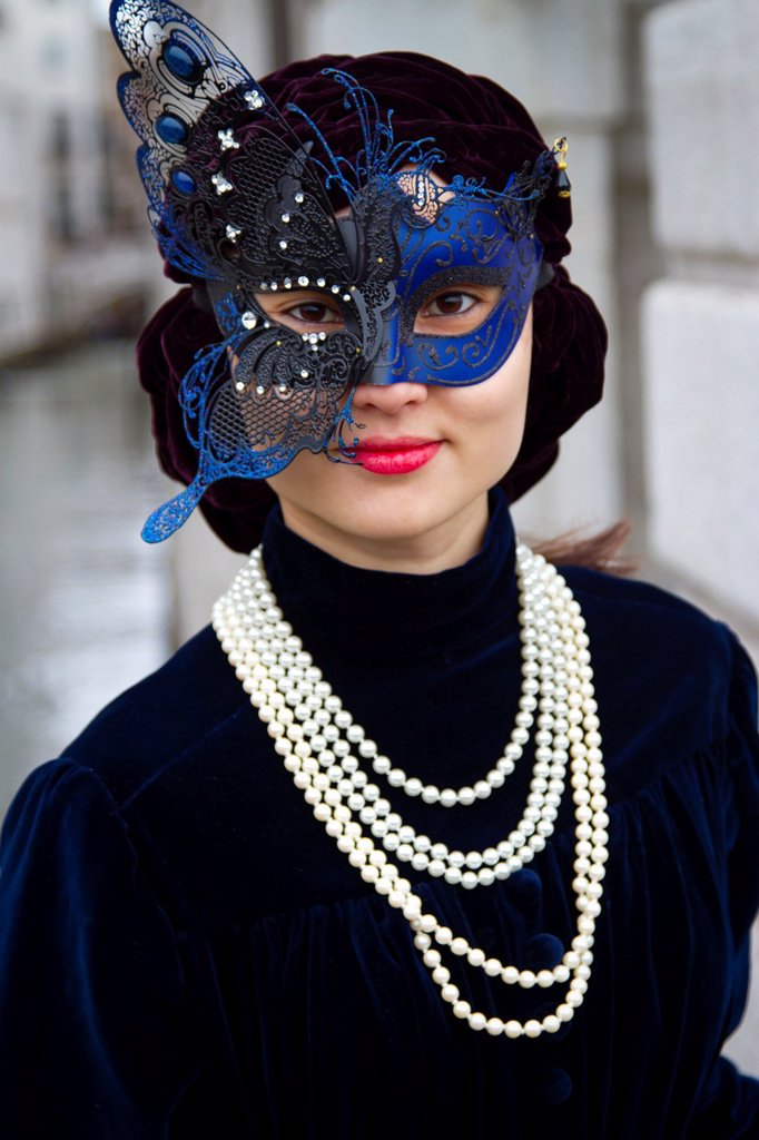 asiatic woman with mask and fancy dress in carnival Venice, Italy : Stock Photo