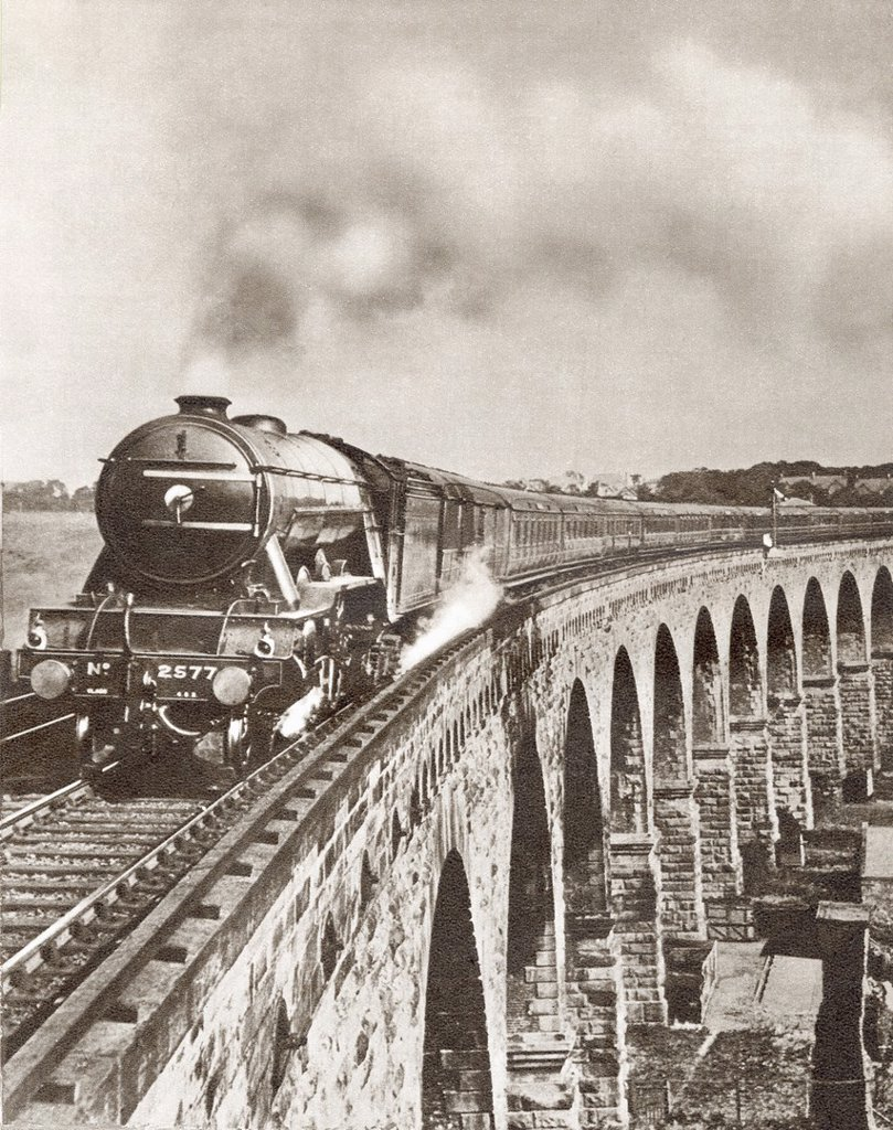 Stock Photo: 1566-1086294 The Flying Scotsman on it´s non-stop journey between London and Newcastle in 1927  From The Story of 25 Eventful Years in Pictures, published 1935