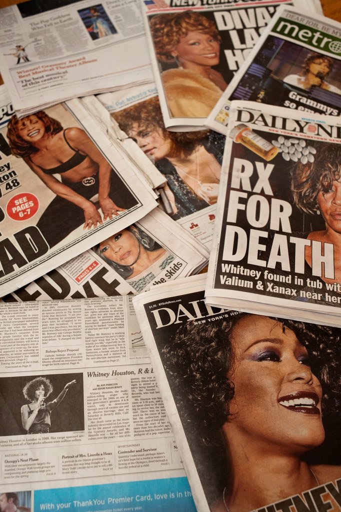 Stock Photo: 1566-1086345 A collection of New York City newspaper covers over several days relating to the death of the singer Whitney Houston on Saturday, February 11, 2012