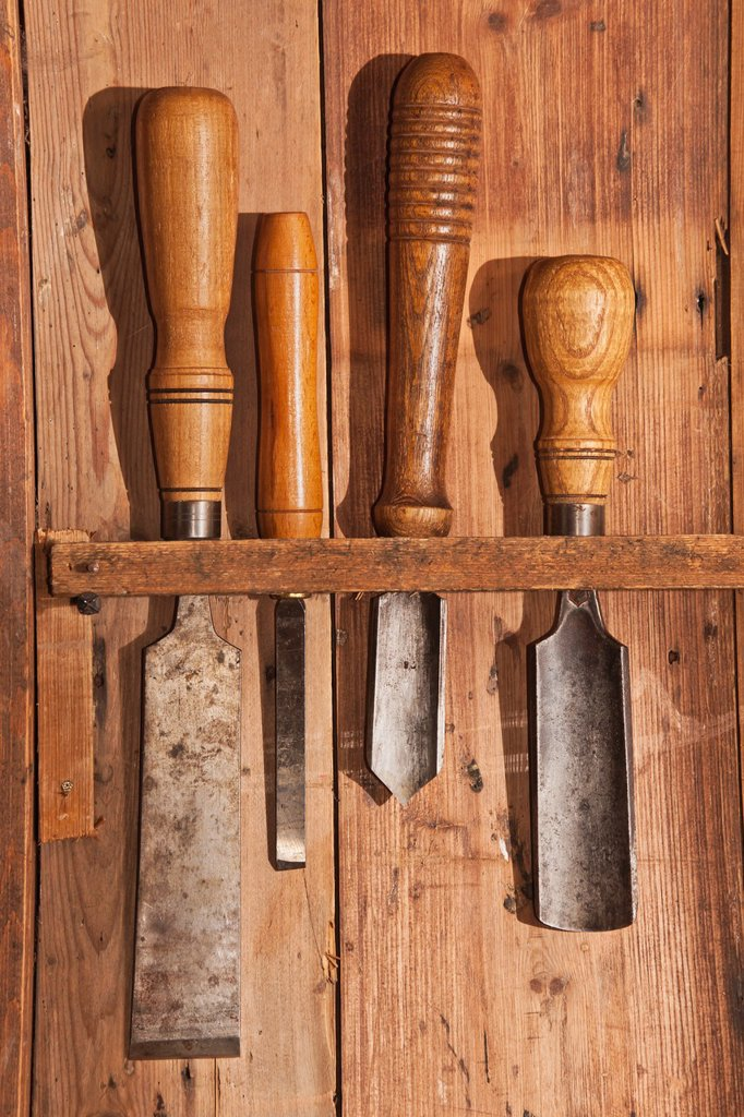 Stock Photo: 1566-1086757 Various tools for woodworking hanging on a wooden wall