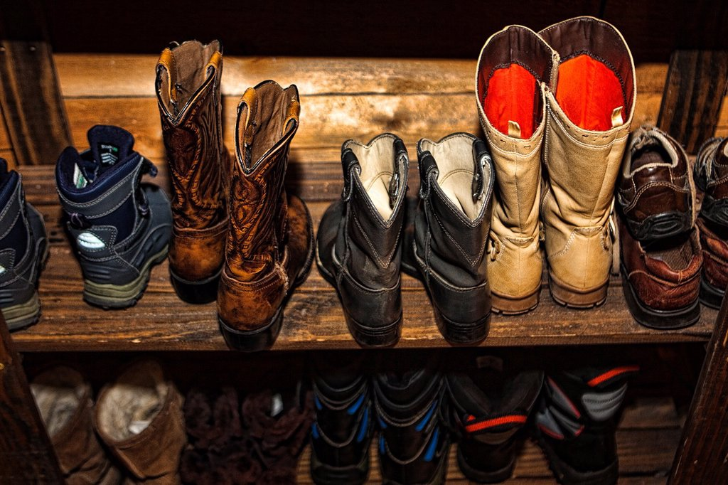 Boots and shoes on shelf. : Stock Photo