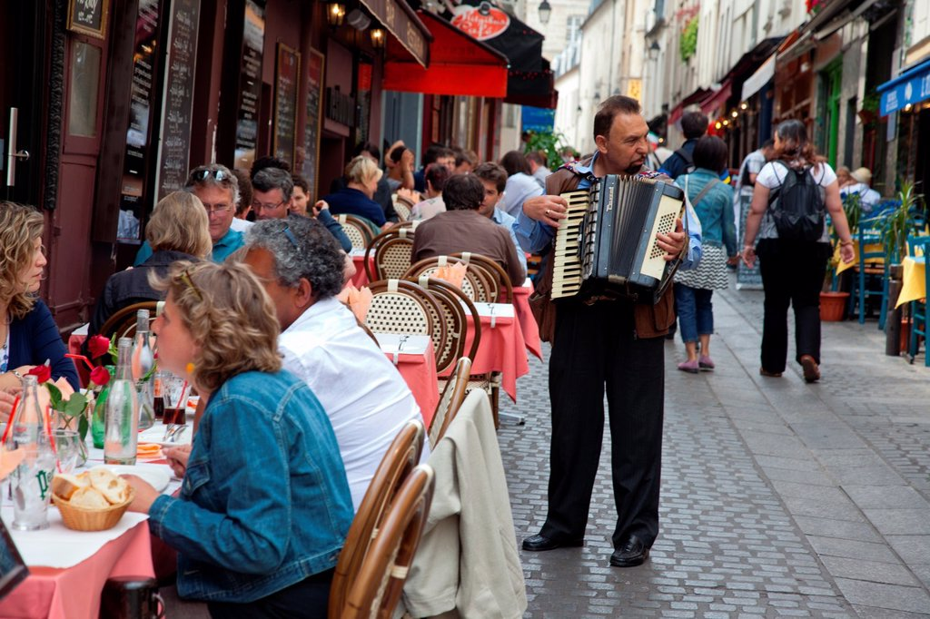 Stock Photo: 1566-1088919 Accordion player entertains lunch time diners in Paris, France